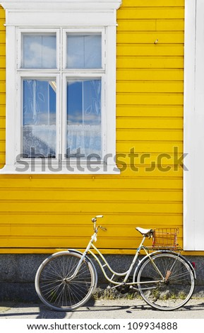 Old bike against the wall  at home - stock photo