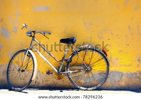 Old bike against the wall at home