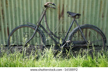 Old bike looks a bit of an old bone shaker, but with alot of time and attention could be restored into new condition