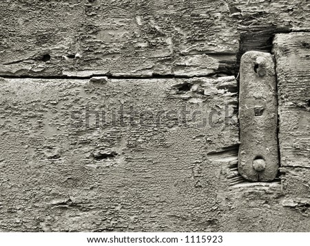 Old black and white wood rough surface - nice background pattern with cracks and crevices with a metal steel element