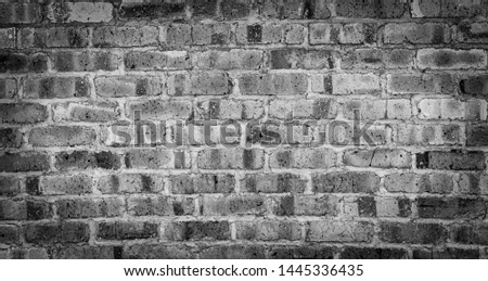 Old black background brick wall line up and white oval, rough surface area, used for placing products or displays with copy space for copying and adding text and images.