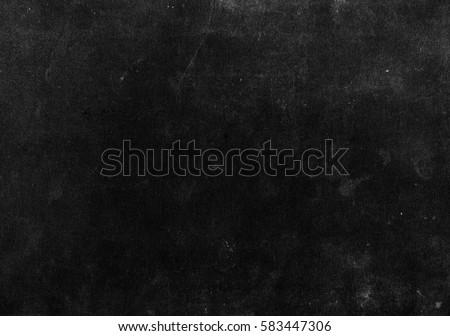 Old black background. Grunge texture. Blackboard