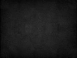 Old black background. Grunge texture. Dark wallpaper. Blackboard. Chalkboard
