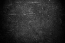 Old black background. Grunge texture. Dark wallpaper. Blackboard. Chalkboard. Concrete wall