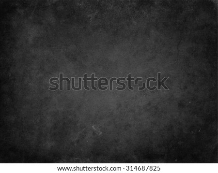 Old black background. Grunge texture. Dark wallpaper. Blackboard. Chalkboard. Wall