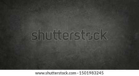 Old black background with grunge texture, distressed vintage paper or wall, elegant gray or charcoal colors