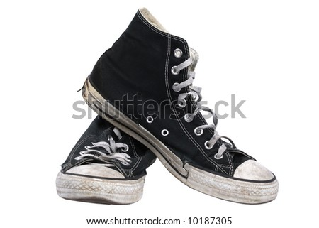 Old black canvas sneakers, isolated with clipping path