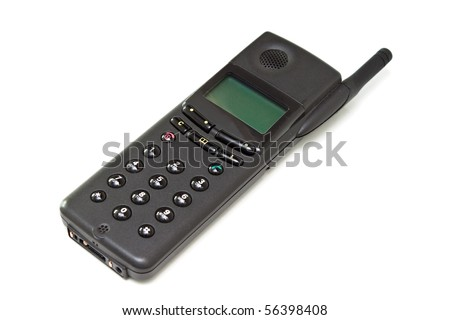 Old black cell phone isolated on the white background.