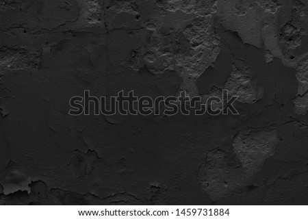 Old black concrete wall background. Photo. Cement texture wallpaper