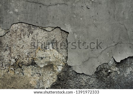 Old black concrete wall. Grunge background. Abstract wallpaper. Distressed texture
