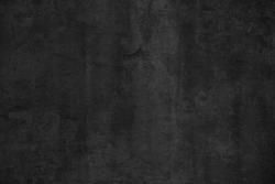 Old black concrete wall. Grunge background. Dark wallpaper. Blackboard