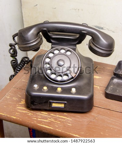 old black dial telephone of the 80s in a office #1487922563