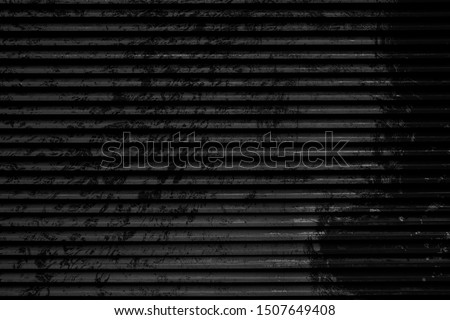 Old black grunge background. Abstract wallpaper