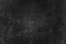 Old black grunge background. Concrete wall. Dark textured wallpaper. Grunge image. Film grain