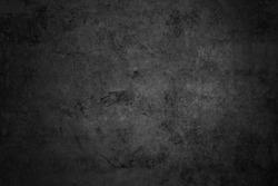 Old black grunge background. Dark grey wallpaper. Cement. Rustic style