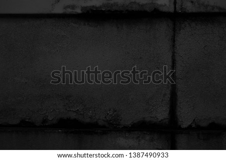Old black grunge background. Textured wallpaper. Concrete wall