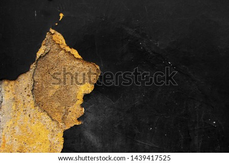 Old black grunge wall. Background. Distressed paint texture