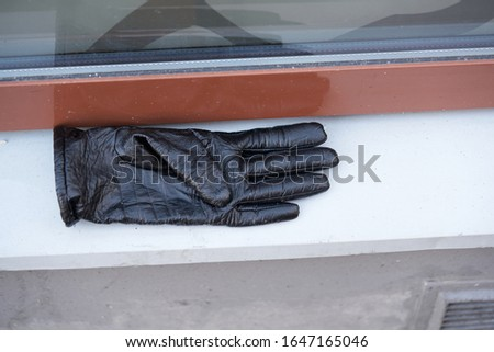 Old black leather gloves lie on a stone Stock photo ©