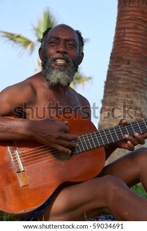 OLD BLACK MEN PLAYING GUITAR ON A TROPICAL ISLAND