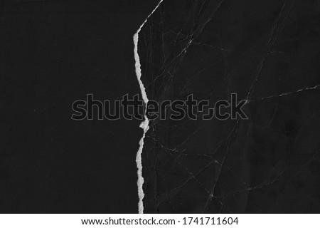 Old black paper texture. Grain texture backgound. Torn page