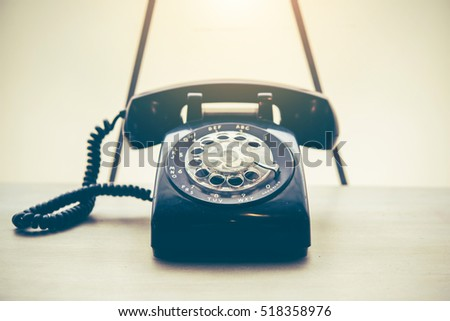 Old black phone on the table with dust and scratches, retro style concept #518358976