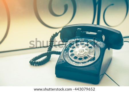 Old black phone with dust and scratches, retro style concept #443079652