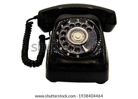 Old black retro rotary Telephone isolated on White background with clipping path. Vintage style. Stockfoto ©