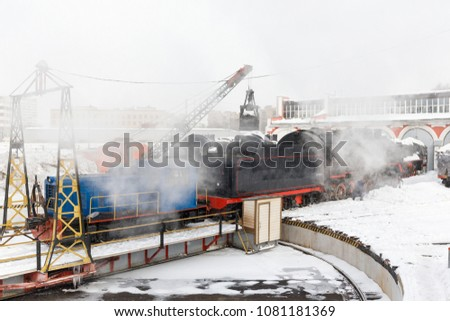 old black steam locomotive and Railway turntable in Russia at the summer at the old railway station