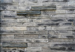 Old black stone brick wall pattern - outdoor architecture detail