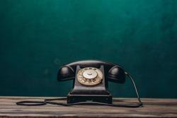 old black telephone on dark background