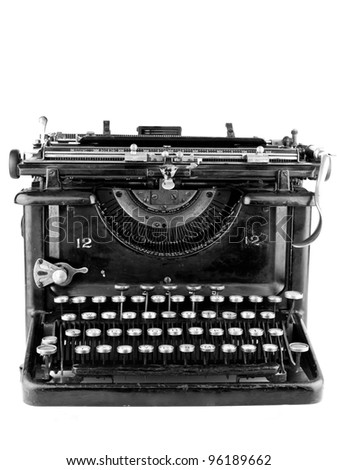 Old black typewriter on a white background