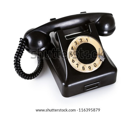 Old black vintage telephone with rotary dial on white background