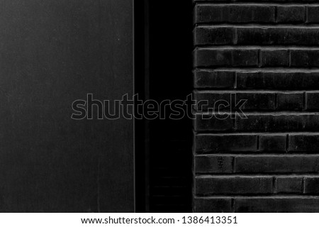 Old black wall. Grunge abstract background. Brick
