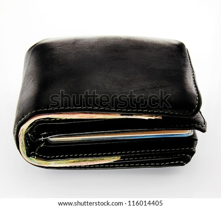 Old black wallet with credit cards and banknotes on white background