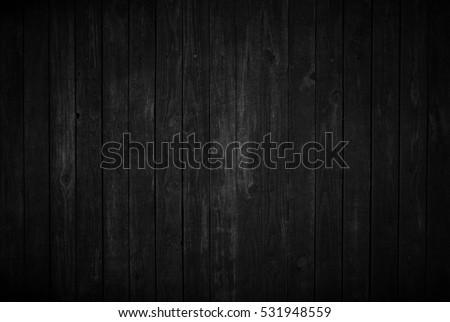 Old black wooden background