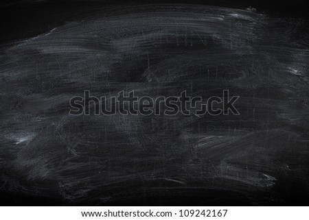 Old blackboard surface useful as education background or texture