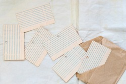 Old blank card files, lined and laid out.  Paper for writing on envelopes from craft paper and white background. A clean, blank page in the ruler. Concept school, note-taking, planning. copy space