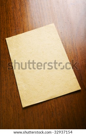 Old blank paper and a scroll on wooden table