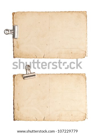 old blank paper photo sheets with clip isolated on white background