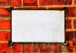Old blank sign on brick wall