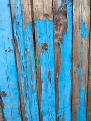 Old blue and brown flayed wooden wal backgroud texture