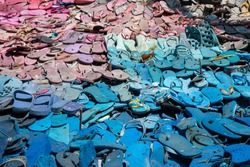 old blue and pink flip flops for recycling