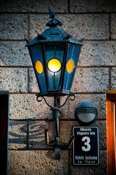 old blue beautiful lantern on old brick wall in street of Riga old town, Latvia