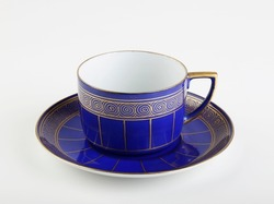 Old blue coffee cup with saucer, gold decore. Mug with saucer.