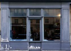 Old blue gray shop front in Paris.