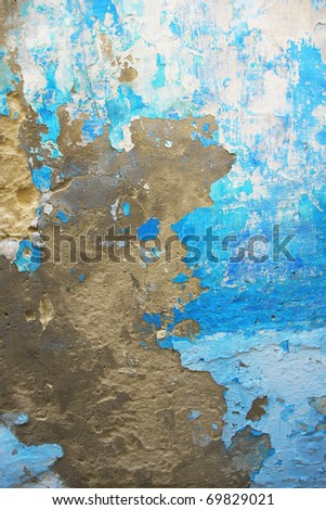 Old blue grungy wall texture. Peeling stained surface background.
