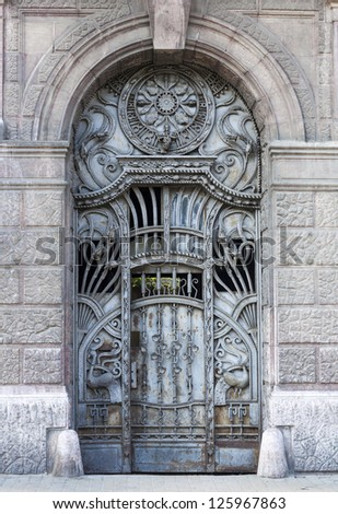 old blue iron entrance door with carving and iron textures
