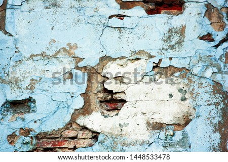 Old blue red brick wall. Abstract background and texture of cracked bricks and blue painted wall. Minimalist abstract painting. Art background spots paint. Abstract art spots of paint. Space for text.