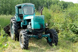 Old blue tractor. Old tractor for agricultural work
