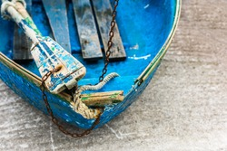 Old blue wooden shabby fishing boat detail. Shot with a selective focus